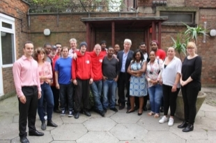 Jeremy Paxman with staff and residents at Caritas Anchor House