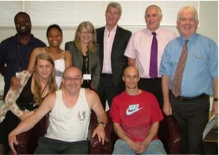 Jeremy Paxman with staff and residents