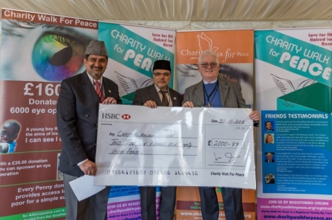 picture of CAH staff member recieving cheque by HSBC award givers