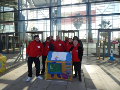 Caritas Anchor House residents pictured with a box