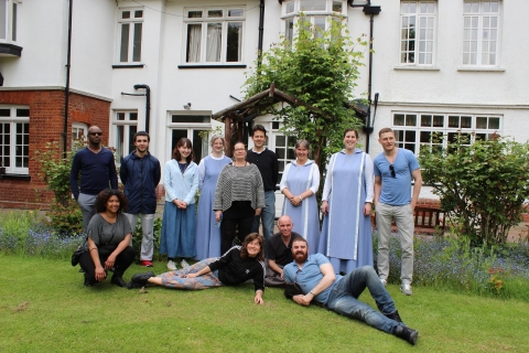 Residents and staff in front of Abbotswick retreat