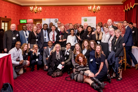 staff residents and volunteers at world homeless day event