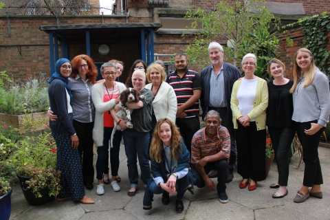 residents and staff pictured with Jeremy Paxman outside