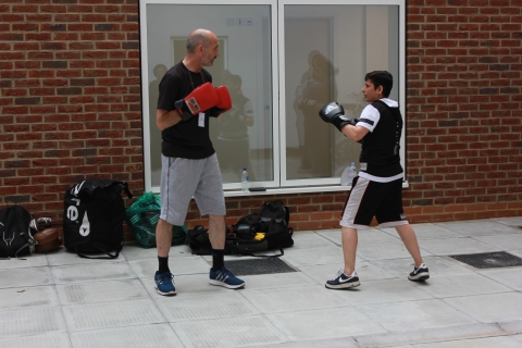 Two males in a boxing stance facing each other