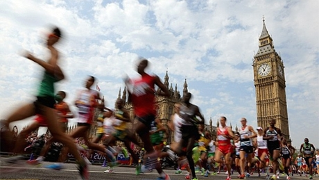Photo of marathon runners passing the Houses of Parliament