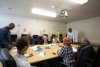 staff and residents pictured in meeting room