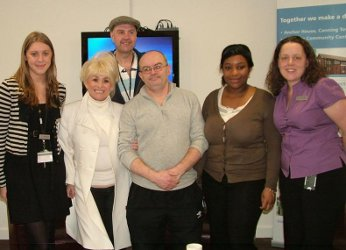 Barbara Windsor MBE with residents and staff at Anchor House